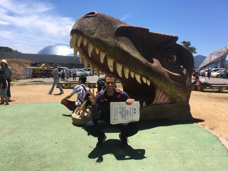 dillon in front of dinosaur head at katsuyama marathon